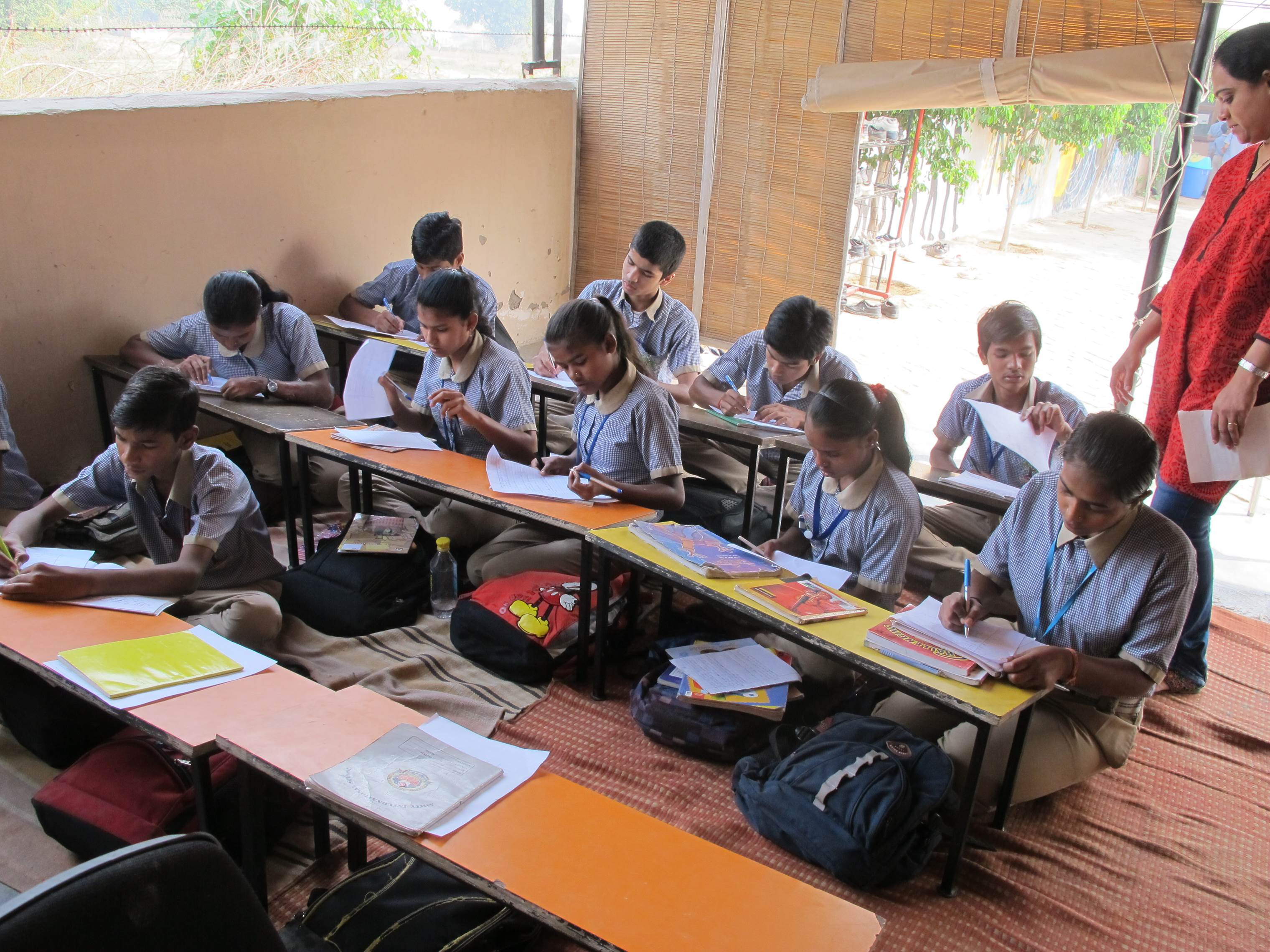 giving smiles and opportunities to children news exam and essay writing in progress